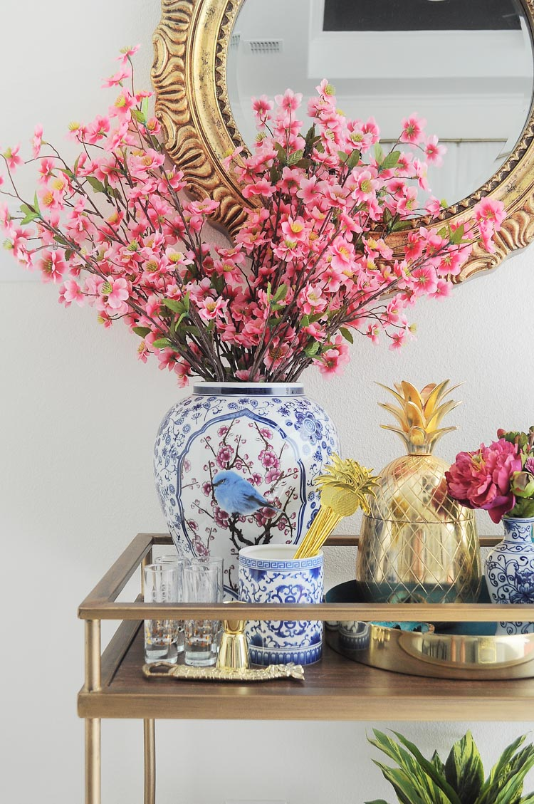 A blue and white with florals chinoiserie and ginger jar inspired bar cart styled for summer soirees and entertaining. So many decor ideas!