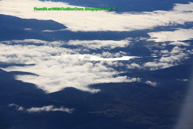 Aerial view of mountain lake over northern Spain from the windows of a commercial airline