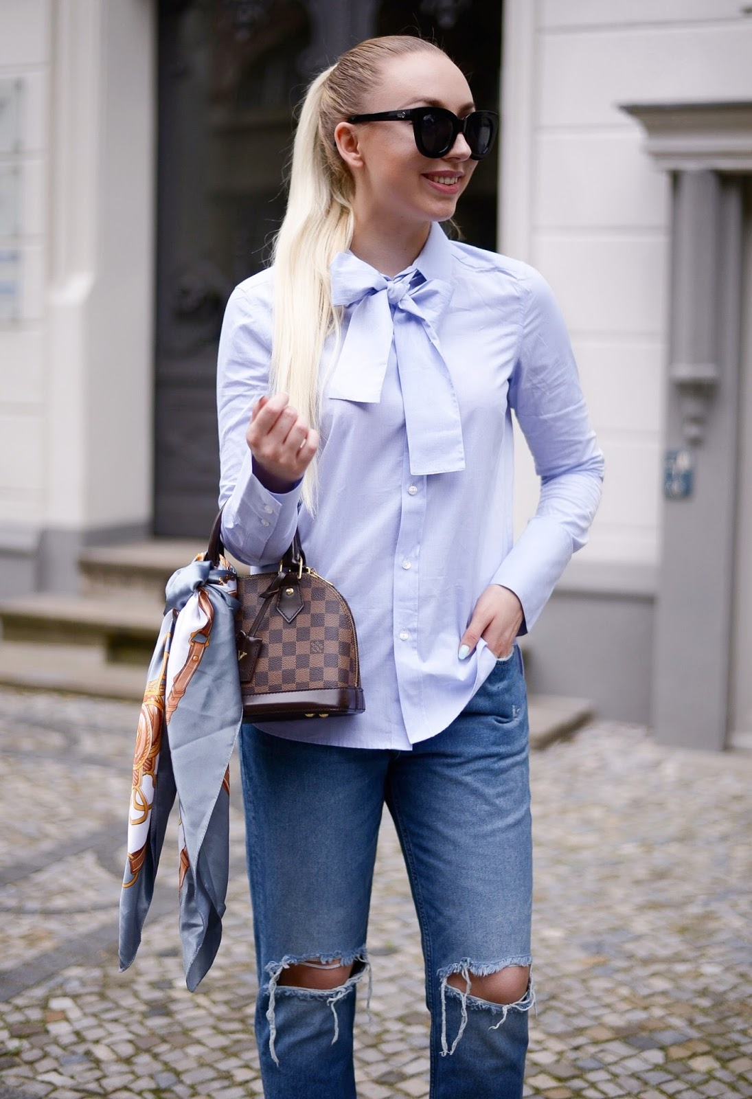 chic baby blue blouse with bow