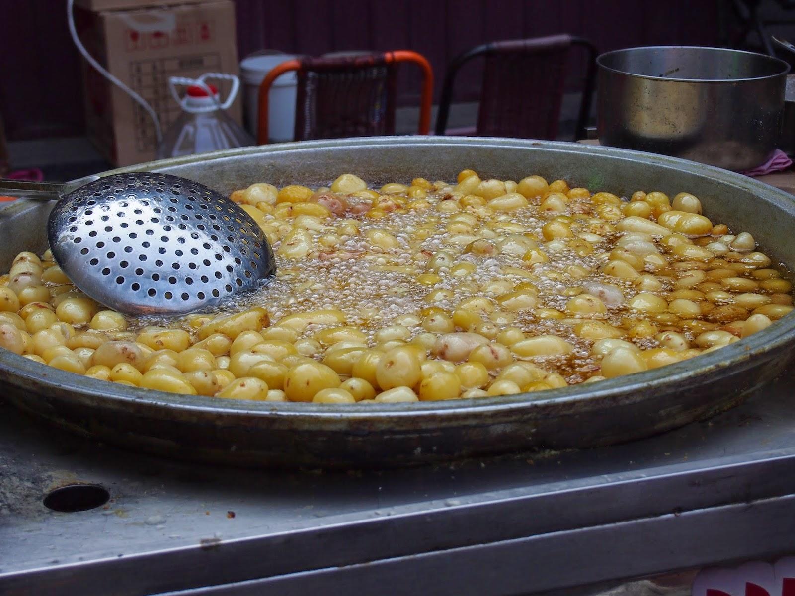 frying potatoes for street food in Xi'an