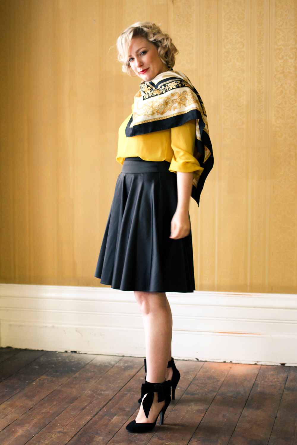 @findingfemme in yellow blouse with black lace collar, black Review Australia skirt, black bow heels and classic scarf.
