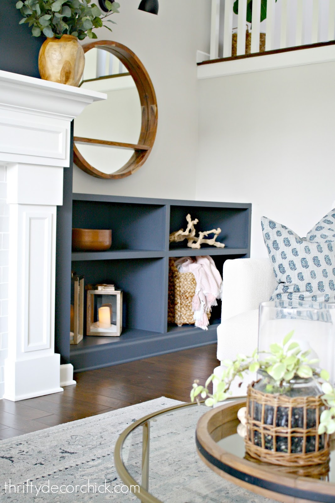 Dark fireplace walls, dark built ins
