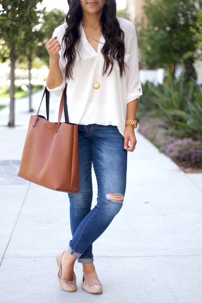 distressed jeans + nude flats + white blouse + tan bag