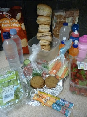 Picture of all the sandwiches, snacks, water, crisps, fruit, buns and yogurts we took on our trip to Legoland on a budget