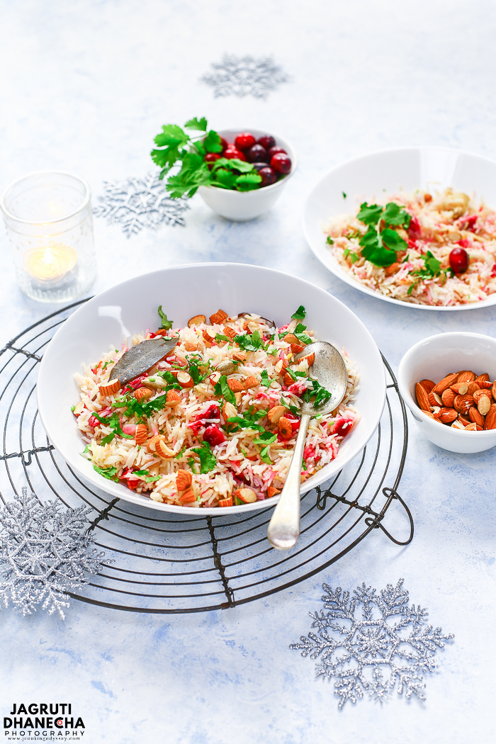 Aromatic and elegant Instant Pot Cranberry and Saffron Rice! A delicious combination of tart fruit and sweet spices. This Persian style vegan and gluten-free rice pilaf or pulao is a perfect side dish to any spicy meal