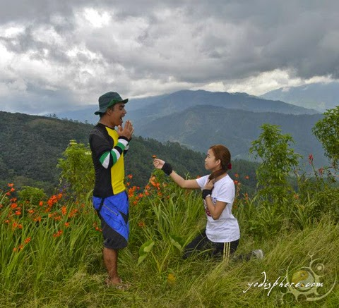 A girl proposing to a mountaineer on top of Mt. Ugo in Benguet hover_share
