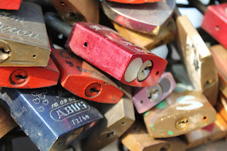 Padlocks with messages of love locked to bridge