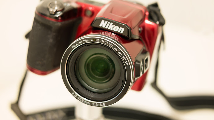 Wallpaper: Nikon Camera with Nikkor Lens