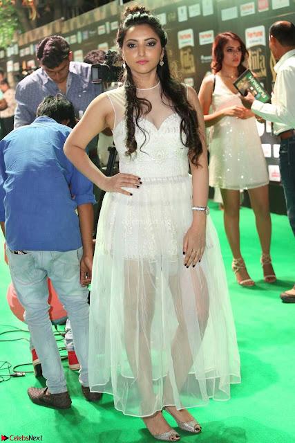 Meghana Gaur in a Deep Neck Sleeveless White Gown at IIFA Utsavam Awards 002.JPG
