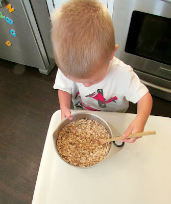 little dude stirring up a batch of oatmeal