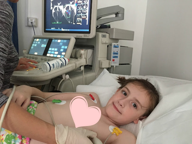 Shows girl having Echo heart scan