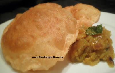 best poori masala image learn from the video recipe poori bhaji fine dining indian.com