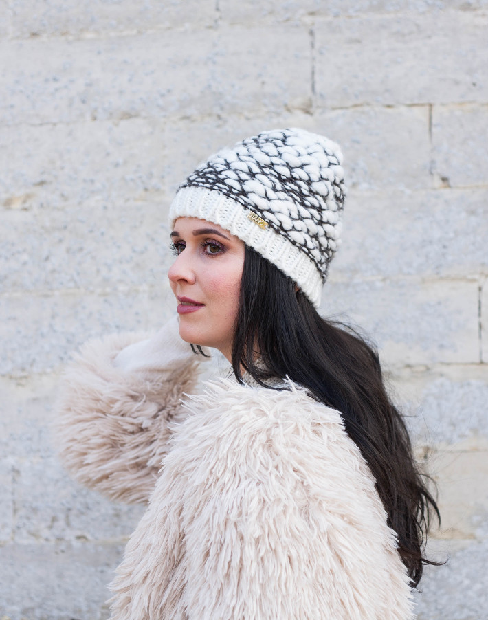 Outfit: cream coloured shaggy faux fur with knit beanie