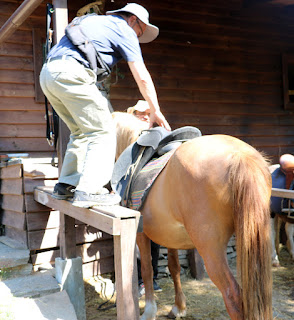 Dad mounts his horse