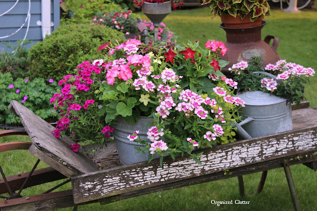 Rustic Garden Wheelbarrow & Laundry Tub Planter Ideas www.organizedclutter.net