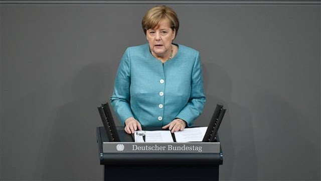 German Chancellor Angela Merkel  says Europe determined to fight climate change