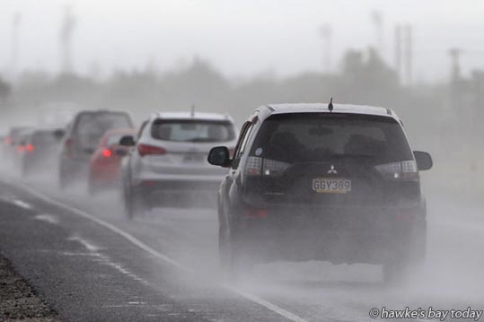 Drivers, cars, motorists on the Hawke's Bay Expressway, driving in the first decent rain in weeks. photograph