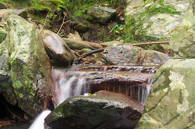 Rocks, stream, trail to waterfalls