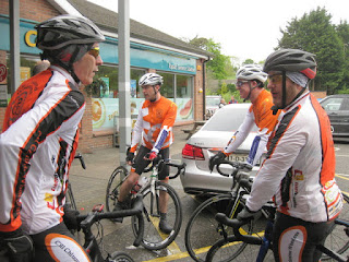 Four cyclists from the Cill Chluana Wheelers refueling, near Armagh, Northern Ireland