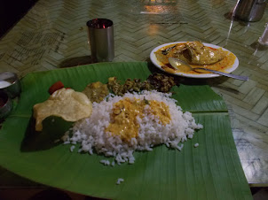 Authentic Kerala fish curry & rice thali served on Banana leaf.
