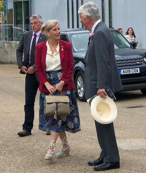 Countess of Wessex wore a floral-print crepe midi skirt by Erdem, Alexander McQueen slim fit blazer, pearl earrings
