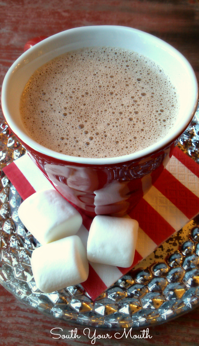 Make hot chocolate for a crowd with this simple homemade recipe for Hot Cocoa that heats and keeps warm in a crock pot or slow cooker.