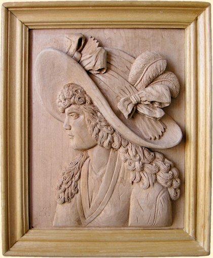 Dama con sombrero. Talla en madera