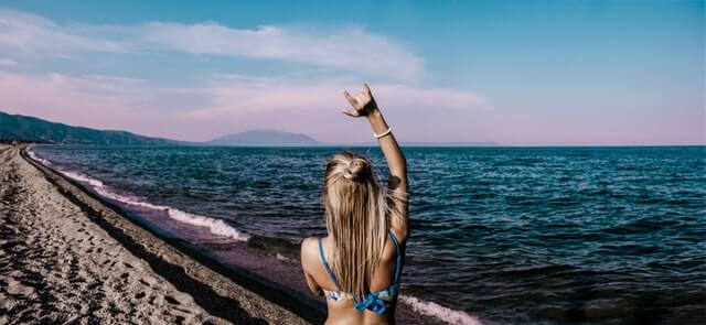 Woman in Blue Bikini Standing Beside Shore HD Copyright Free Image