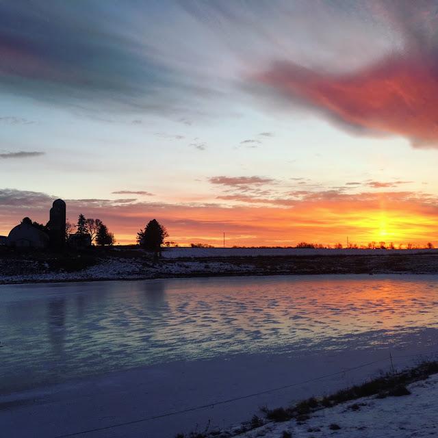 sunrise over dairy farm
