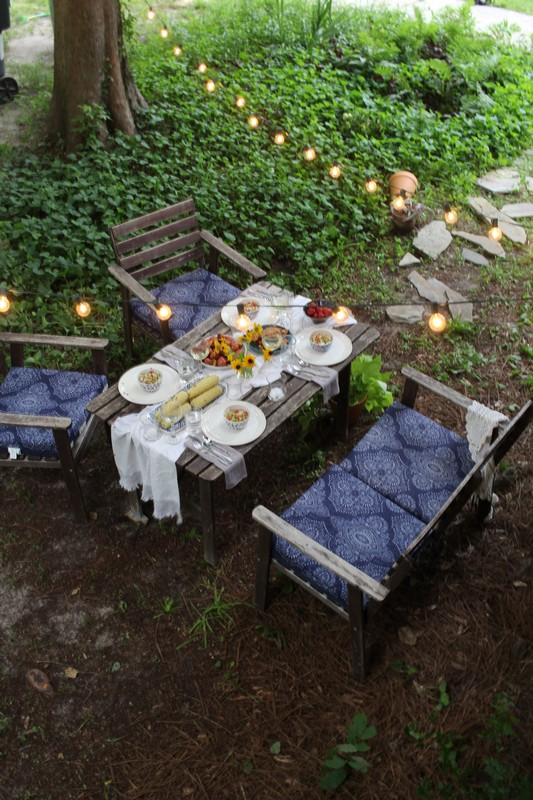 Alfresco garden dining under string lights