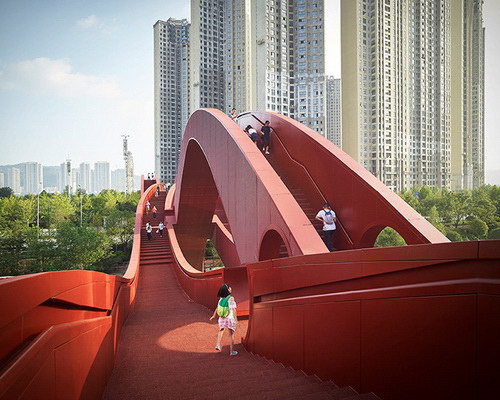Tinuku NEXT Architects translates Möbius strip for Lucky Knot bridge in Changsha Meixi Lake District