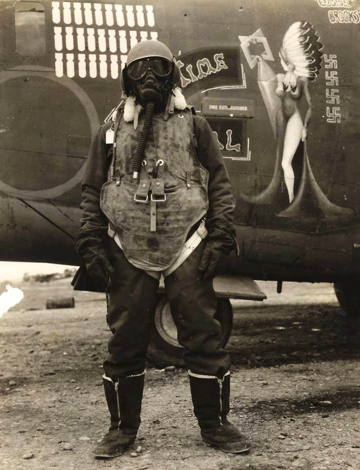 An aircrewman with the 743rd Bomb Group standing in front of B-24H Liberator 'TePee Time Gal' wearing typical protective clothing, San Giovanni Airfield, Foggia, Italy, 1944-45.