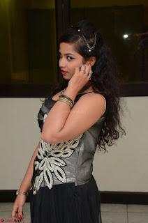 Shrisha Dasari in Sleeveless Short Black Dress At Follow Follow U Audio Launch 044.JPG