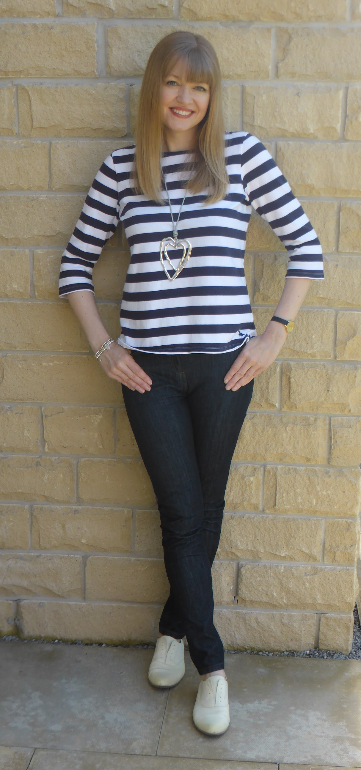 Over 40 blogger What Lizzy Loves wears Jack Wills breton top with skinny jeans and yellow Clarks brogues