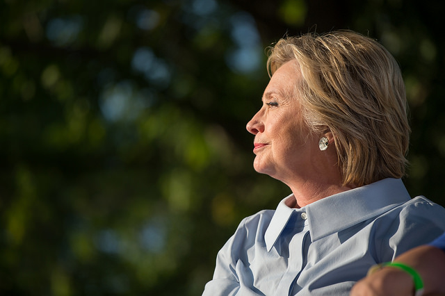 image of Hillary Clinton in profile, sitting outdoors in the sunshine