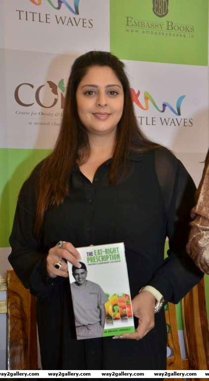 Nagma made a rare appearance at the book launch of Dr Muffazal Lakdawalas The EatRight Prescription in Mumbai