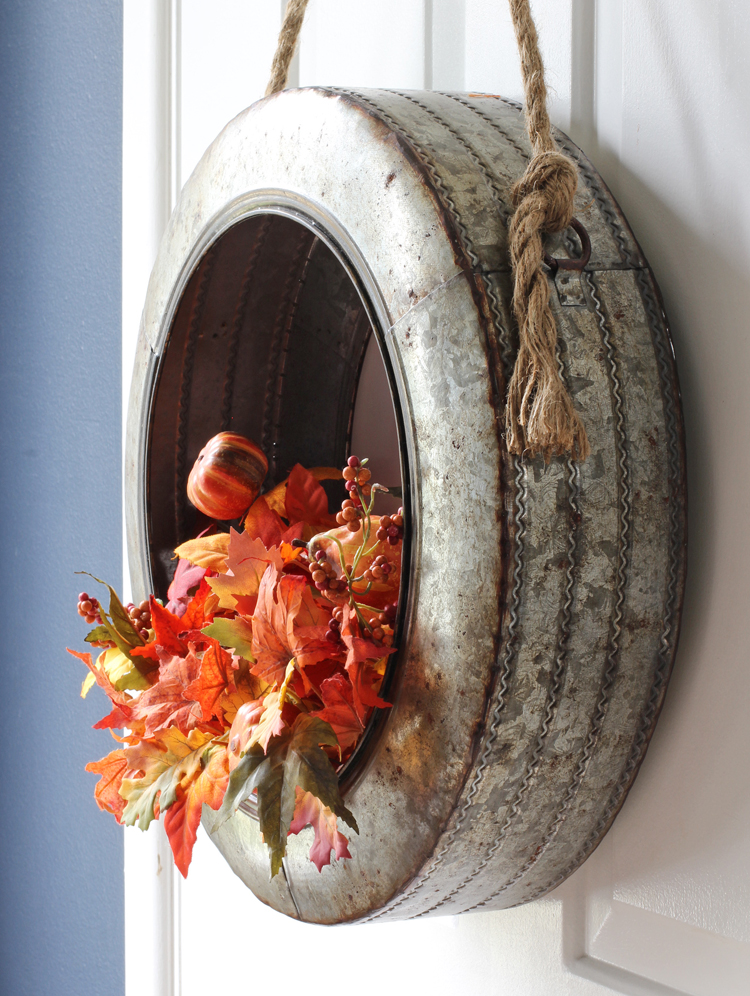 Simply swap out the floral stems in this metal tire wreath for every season of the year
