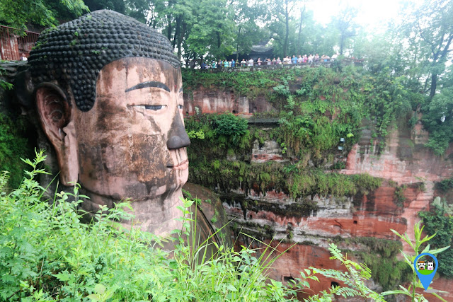 The head of Leshan Giant Buddha can be seen as you walk down the stairway in Sichuan province of China