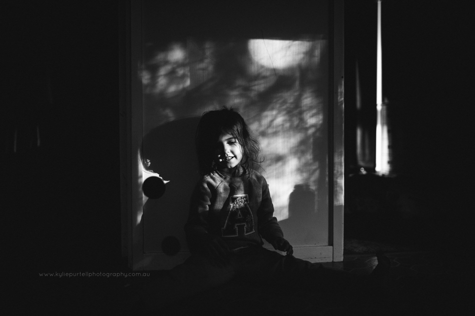 Moody black and white image of child playing