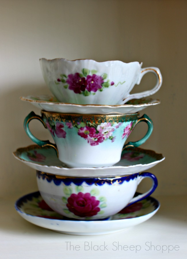 Vintage tea cups stacked for display.