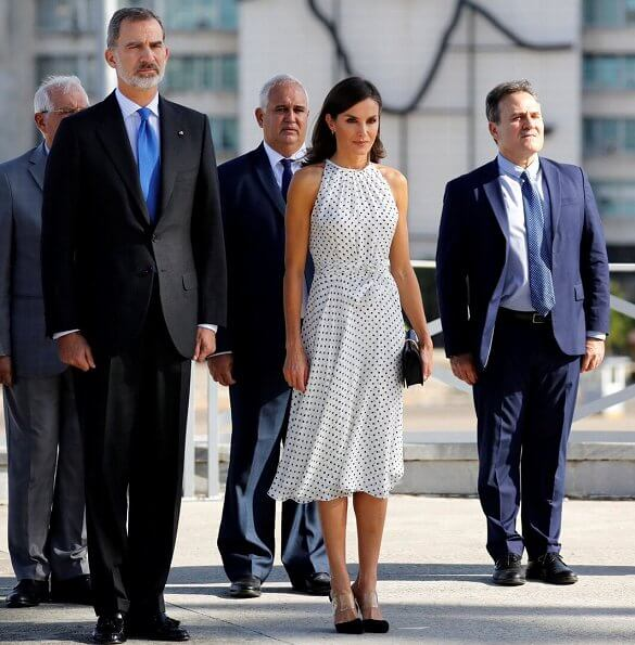 Queen Letizia wore Carolina Herrera polka dot silk dress, Steve Madden suede pumps and carried Nina Ricci Arc clutch