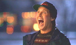 Chevy Chase delighted Christmas Vacation 1989 movieloversreviews.filminspector.com
