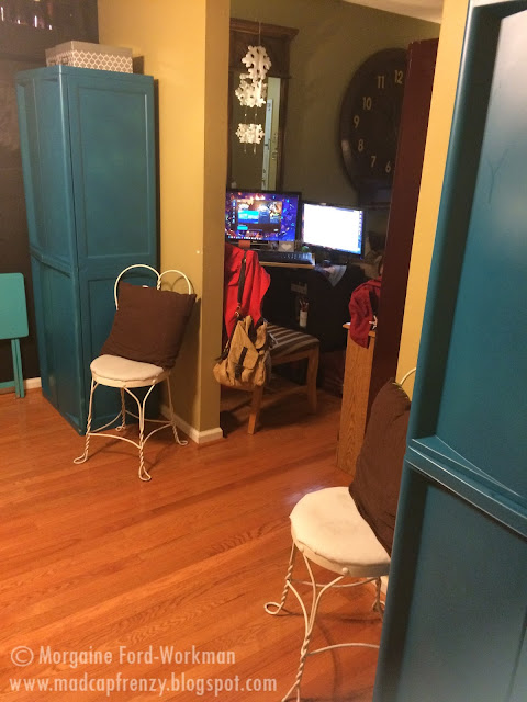 teal craft storage cabinets in dining room