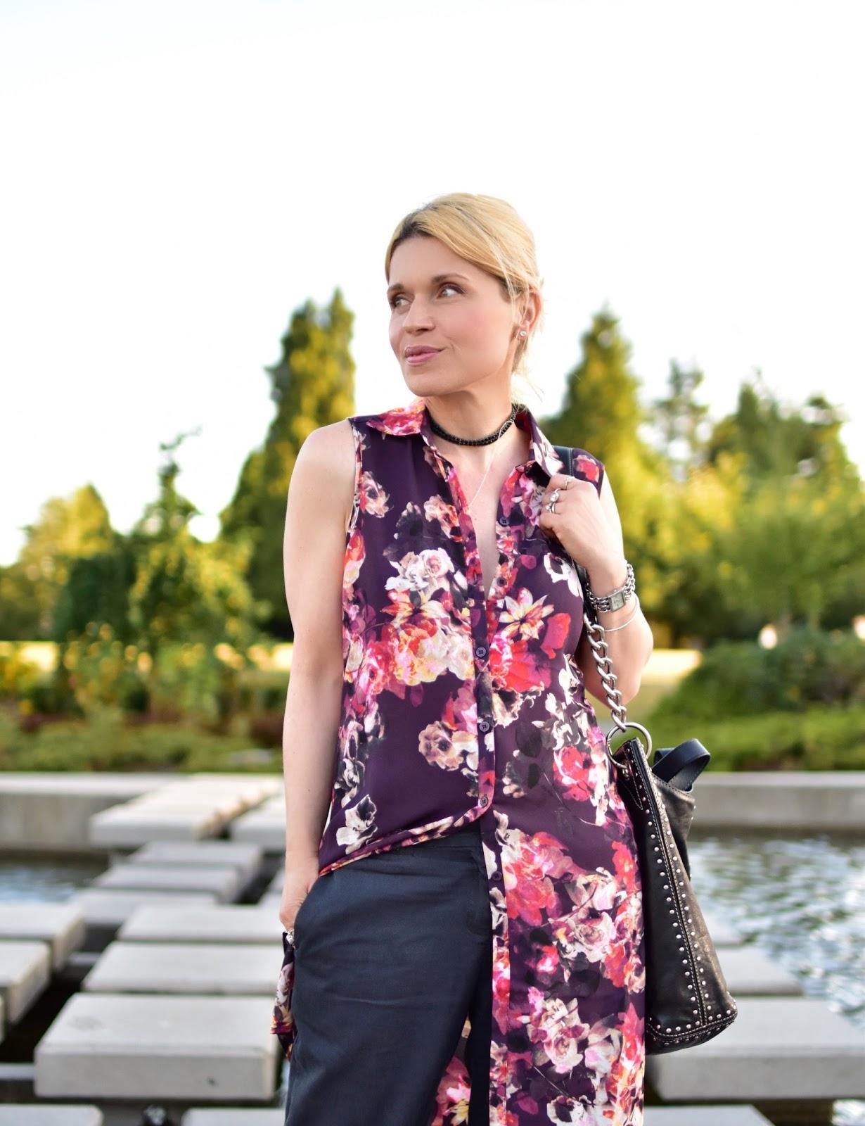 floral tunic-style blouse, boyfriend trousers, MK bag