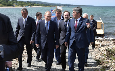 Vladimir Putin took part in a ceremony releasing Baikal omul fry into Lake Baikal.