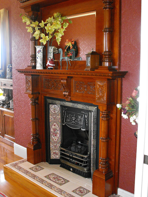 Wooden mantlepiece surround and tiled fireplace