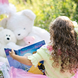 Girl reading Beauty and the Beast