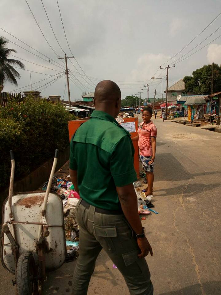 Green Uniform Men Arrest Young Lady Who Dumps Refuse On The Ground And Forces Her To Do This