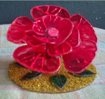 Bunga mawar dari CD/DVD bekas