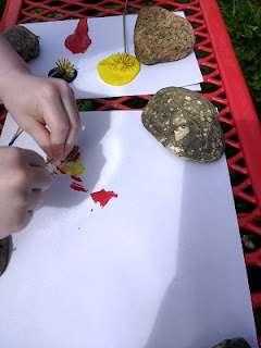 Preschooler beginning to paint with flowers